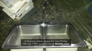 P002 - Stainless kitchen sink w/ faucet - $60
