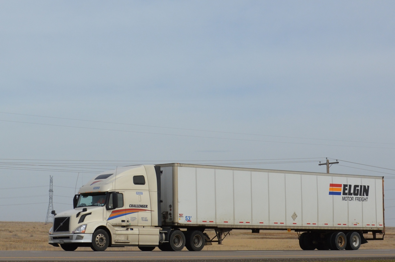VNL670 caught on the Trans-Canada Hwy east of Medicine Hat, AB in October 2014, with a trailer marked for Elgin Motor Freight.