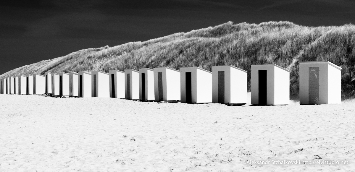 Locker-rooms on the beach on a bright sunny day by Alexandr elvistudio Stzhalkouski