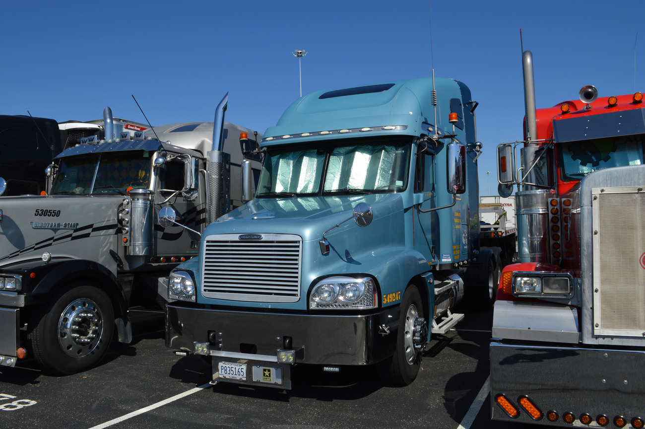 Really nice Kenworth W900L leased on with Admiral Merchants Motor Freight Inc. from Minneapolis, MN